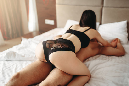 Intimate games in bed, passionate lovers