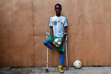 Amputee football player Daniel Ahize poses for a portrait photograph after a training session at the national stadium in Surulere district in Lagos