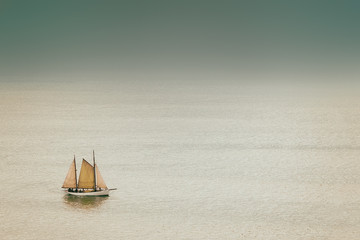 old and antique sailboat with vintage effect on sea