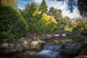Idyllic picturesque landscape with waterfall and beautiful stone bridge. English river scene.