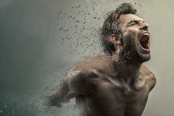 Screaming frustrated man dispersing and disintegrating into particles, agonizing and torturing expression Wall mural
