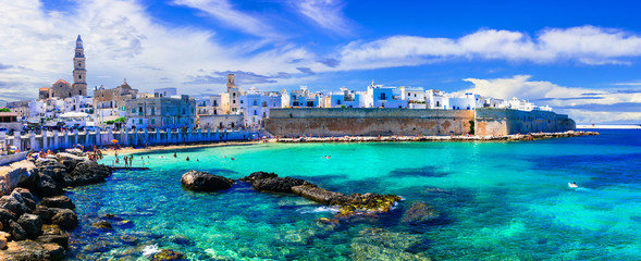 Beautiful white town Monopoli in Puglia with turquoise sea. Italy Fototapete