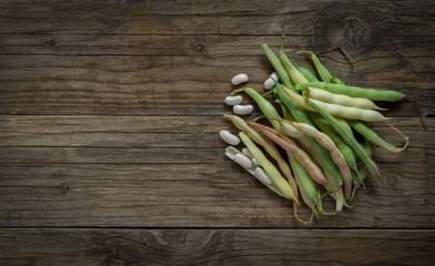 fresh white beans on wooden table