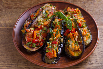 Pan fried eggplants with tomatoes, paprika, carrot, onion and garlic