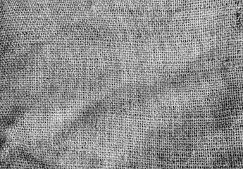Old vintage linen cloth textile. Burlap rustic tumbled texture background.