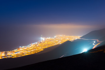 Aerial view of the port city of Iquique in the coast of the Atacama desert at dawn, Chile