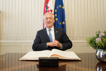 U.S. Secretary of Defense James Mattis smiles after signing the guest book before meeting with Croatian Prime Minister Andrej Plenkovic in Zagreb