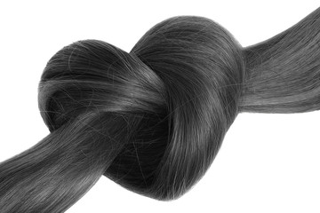 Black hair knot in shape of heart, isolated on white background.