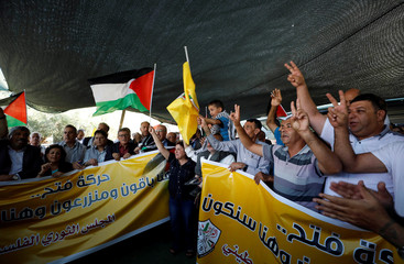 Palestinians gesture and shout slogans during a meeting of Fatah Revolutionary Council at the Bedouin village of Khan al-Ahmar in the occupied West Bank