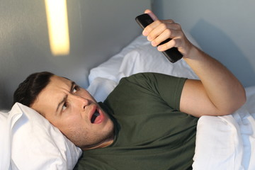 Shocked man receiving a message at night