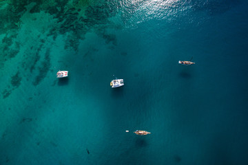Small boats navigating beautiful blue ocean