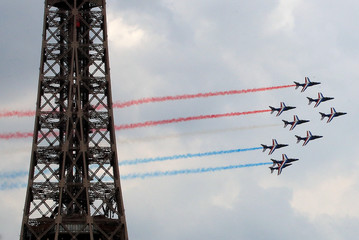 Alpha jets from the French Air Force Patrouille de France fly past the Eiffel Tower in Paris
