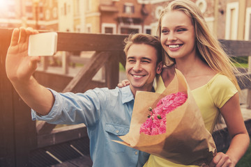 Romantic Young Couple Making Selfie Using Phone