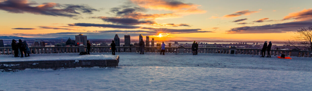 People enjoying the view of Montreal during the sunrise