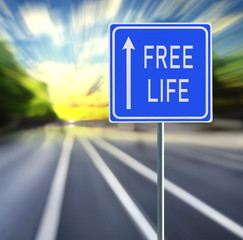 Free Life Road Sign on a Speedy Background with Sunset.