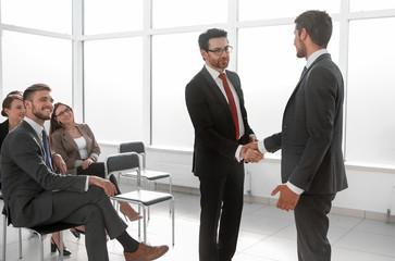 businessmen handshaking after striking grand deal