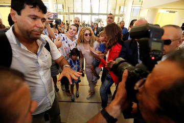 Colombian singer Shakira arrives with her kids at the airport in Beirut