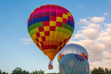 Hot air balloon under blue sky.