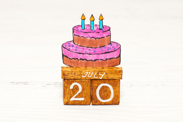 Jule 20th - International Cake Day on wooden calendar with funny picture