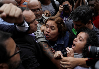 Demonstrators against Rio de Janeiro's Mayor Marcelo Crivella argue with Crivella's supporters during a protest in front of the Legislative Assembly in Rio de Janeiro