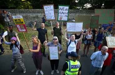 Demonstrators protest outside the grounds of Blenheim Palace, where U.S. President Donald Trump and the First Lady Melania Trump are attending a dinner with Britain's Prime Minister Theresa May and business leaders, near Oxford