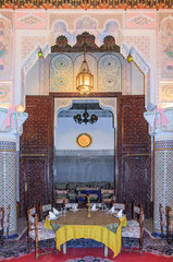 Moroccan restaurant decorated with mosaic and carvings in Fes