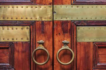 Ornate Moroccan wooden door in a riad