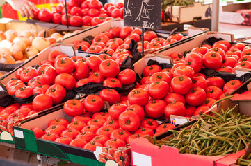 closeup of tomatoes piles at the market