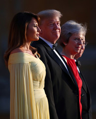 British Prime Minster Theresa May and her husband Philip stand together with U.S. President Donald Trump and First Lady Melania Trump at the entrance to Blenheim Palace near Oxford