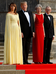 British Prime Minister Theresa May and her husband Philip stand together with U.S. President Donald Trump and First Lady Melania Trump at the entrance to Blenheim Palace near Oxford