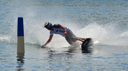 Recess Fitting Water Motor sports Male Motosurf Competitor Taking corner at speed creating a lot of spray.
