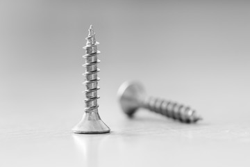 Screws, connect, fix, industry, thread. Monochrome detailed photo.