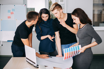Interior designers team working with color palettes and drawings in studio. Design, innovations, creative work, developing and new projects