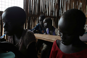 Internally displaced children attend a class session in the UNMISS Protection of Civilian 3 site outside Juba