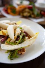 Delicious and healthy Raw Food: Insalata di Indivia. Endive salad with gorgonzola, pear, walnuts and mustard dressing. Natural light.