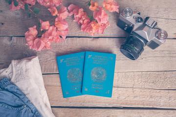 Wooden Background of the traveler girl. Clothing, Luggage, flowers, passports of Kazakhstan. Toning.