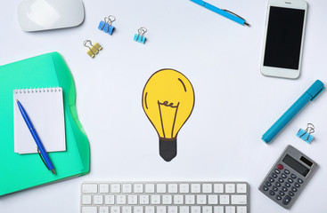 Bulb drawing, mobile phone and office stationery on white background. Business  trainer concept