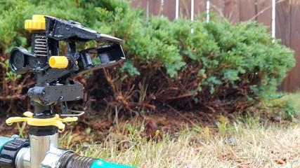 Wet sprinkler in close up after watering the garden 5