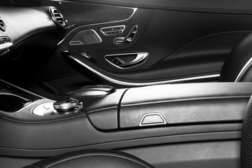 Modern Luxury car inside. Interior of prestige modern car. Comfortable leather seats. Perforated leather cockpit. Modern car interior details. Black and white