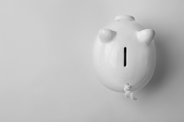 Cute piggy bank on white background, top view