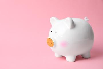 White piggy bank on color background. Money saving