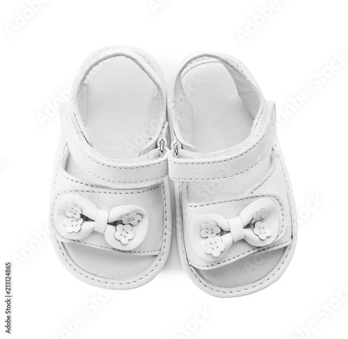fea16f056b54e Pair of cute baby sandals decorated with bows on white background ...