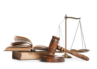 Wooden gavel, scales of justice and books on white background. Law concept