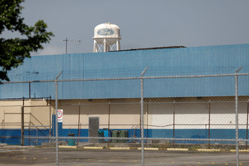 The corporate logo of Ford is seen on a water tank at the facilities of the company in Valencia
