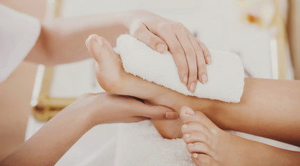 Photo sur cadre textile Pedicure Beautiful Clean Female Legs in Spa Composition.