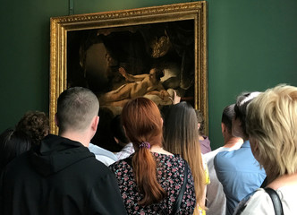Visitors look at the Rembrandt painting Danae at the State Hermitage museum in St. Petersburg