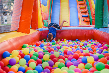 Inflatable castle full of colored balls for children to jump