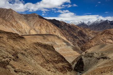 ChangLa Pass, Ladakh India. High Altitude mountain pass, snow mountains in the background with a canyon/valley in the foreground. Road between Zingral and Durbuk. Grand landscape with huge mountains.