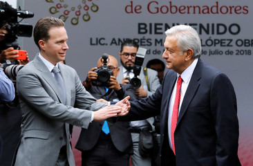 Mexico's President-elect Andres Manuel Lopez Obrador is welcomed by Chiapas Governor Manuel Velasco as he arrives to a meeting with state governors in Mexico City