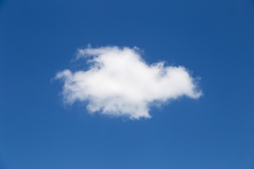 One beautiful cloud in the sky. The blue background is beautiful.